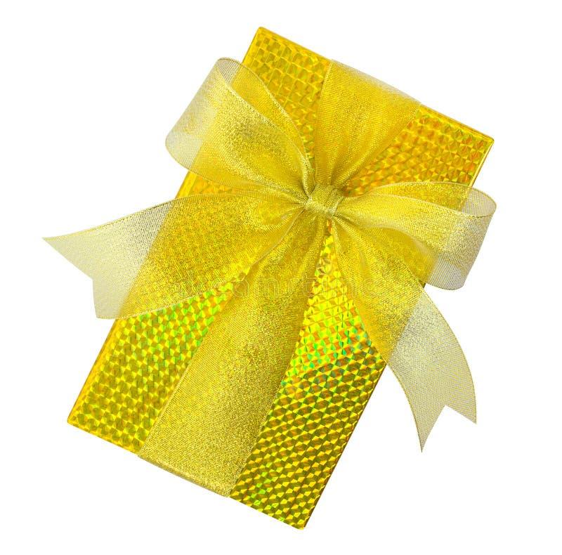 在白色有金丝带弓顶视图隔绝的金黄礼物盒 免版税库存图片