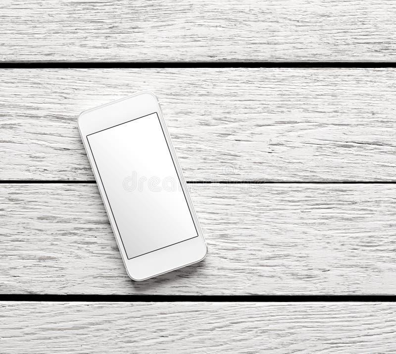 在白色木书桌上的白色巧妙的电话 库存照片