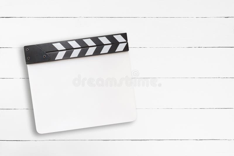 在白色木背景的白色空白的拍板 免版税库存照片
