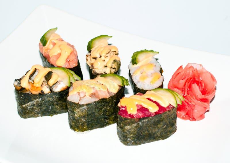 在白色板材的寿司 图库摄影