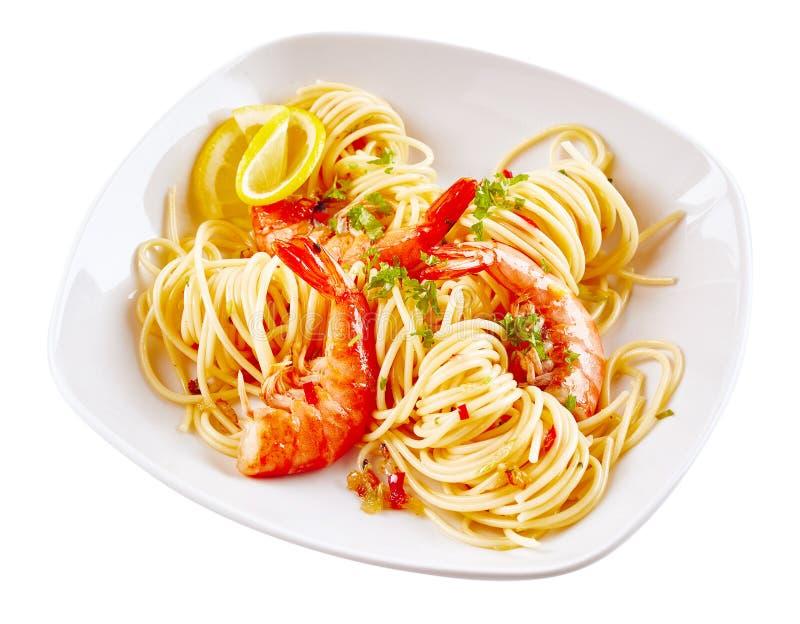 在白色板材的食家海鲜肉菜饭面团 库存图片