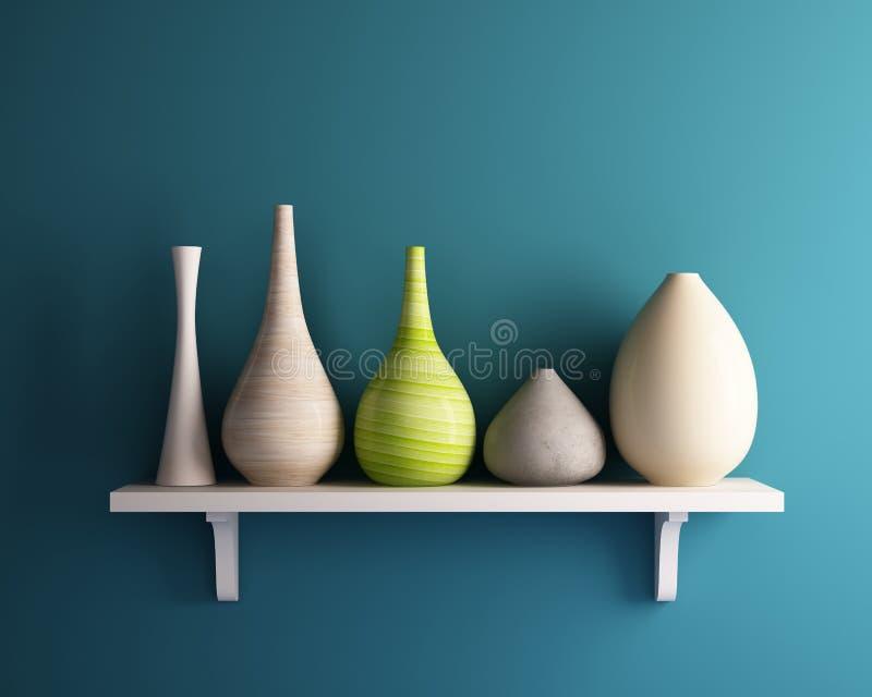 在白色架子的花瓶与蓝色墙壁 皇族释放例证