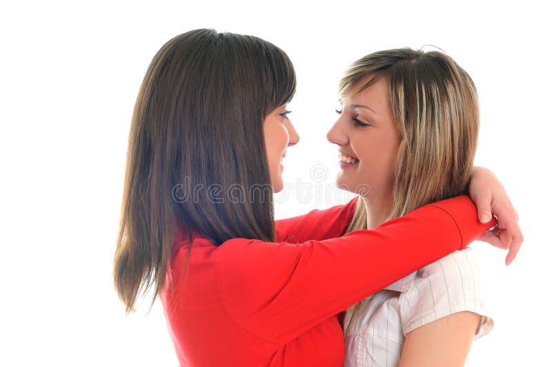 在白色查出的二个女孩 库存图片
