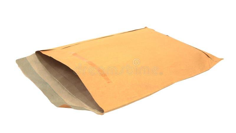 在白色查出的老棕色信包 免版税库存图片