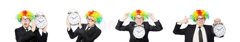 在白色滑稽的概念的商人小丑隔绝的 免版税库存照片