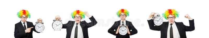 在白色滑稽的概念的商人小丑隔绝的 免版税库存图片