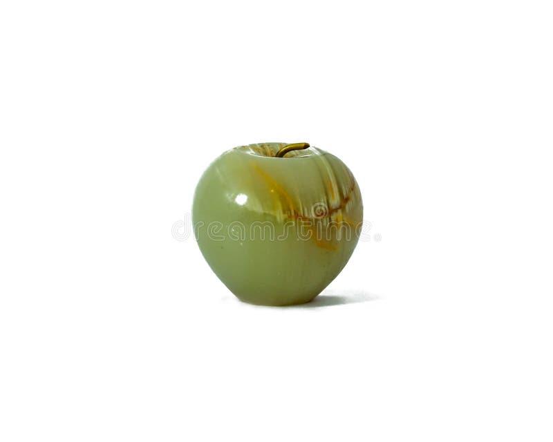 在白色的一个绿色水晶苹果 库存照片