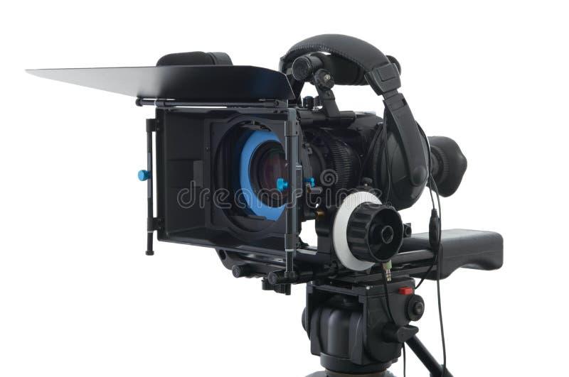 在白色的专业摄象机 免版税库存照片