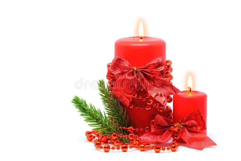 在白色的两个红色蜡烛 库存照片