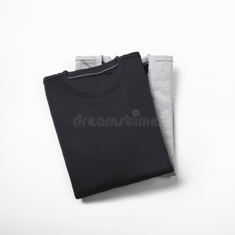 在白色的两件空白的套头衫 库存照片