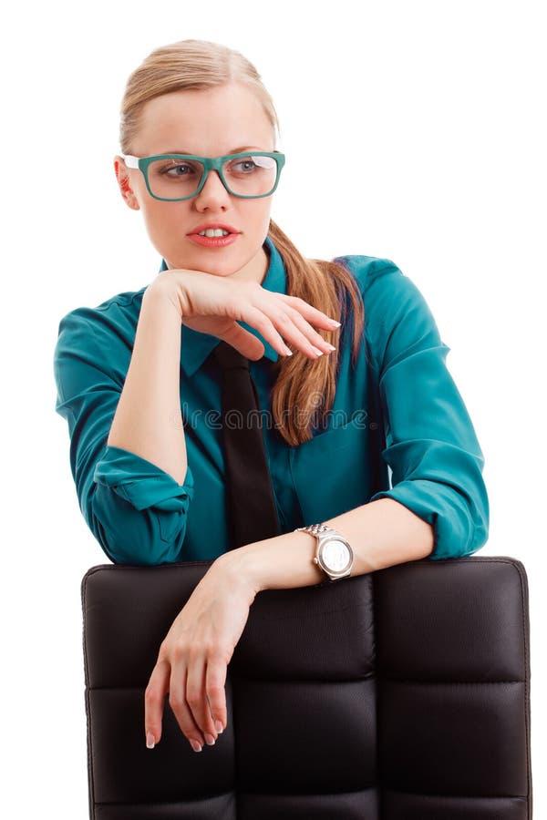 在白色的严重女实业家 免版税图库摄影