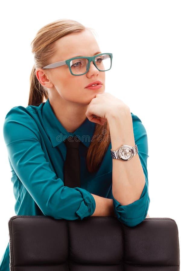 在白色的严重女实业家 库存照片