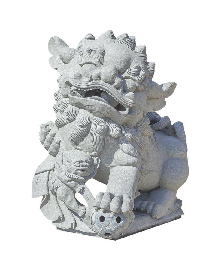 在白色的中国石狮子雕象 免版税库存照片
