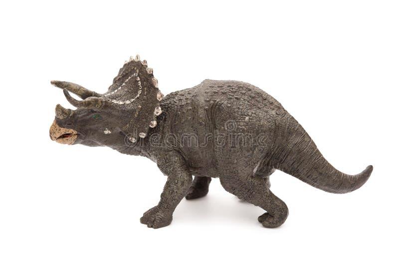 在白色的侧视图灰色三角恐龙玩具 免版税库存图片