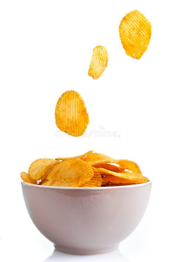 在白色的土豆片 免版税库存图片