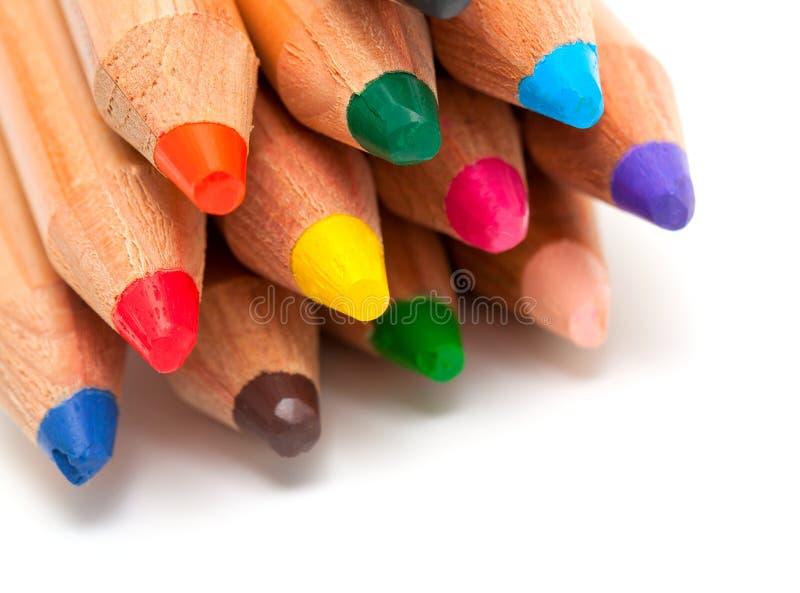 在白色的小孩铅笔 免版税库存照片