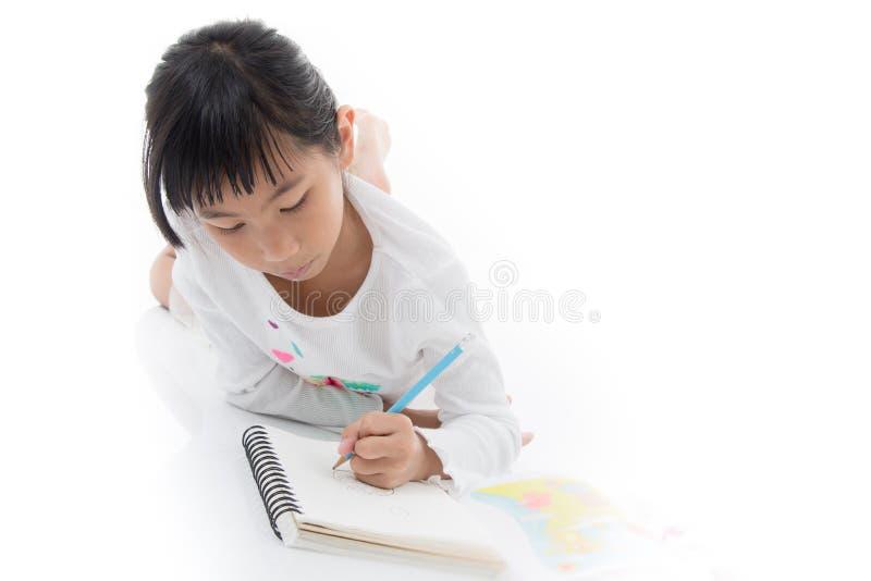 在白色的小的亚洲艺术家儿童图画 免版税图库摄影