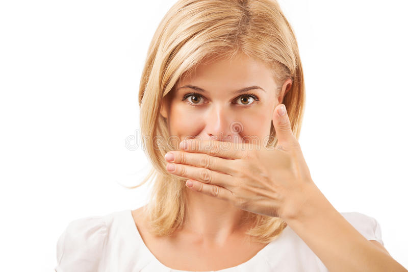 在白色的微笑的少妇覆盖物嘴 免版税库存图片