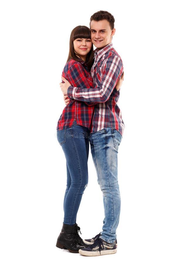 在白色的愉快的少年夫妇 图库摄影