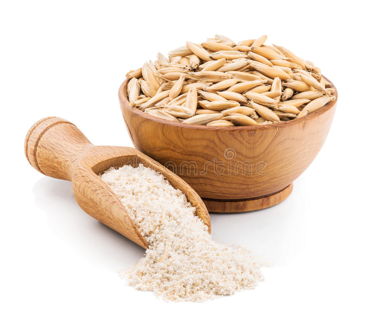 在白色的整个五谷燕麦面粉 免版税库存照片
