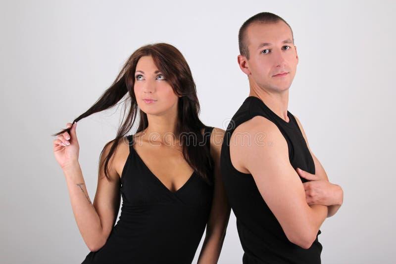 在白色的新夫妇男人和妇女 免版税库存图片