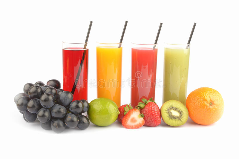 在白色的新鲜水果汁 库存照片