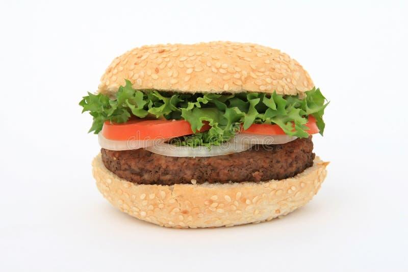在白色的牛肉汉堡 库存照片