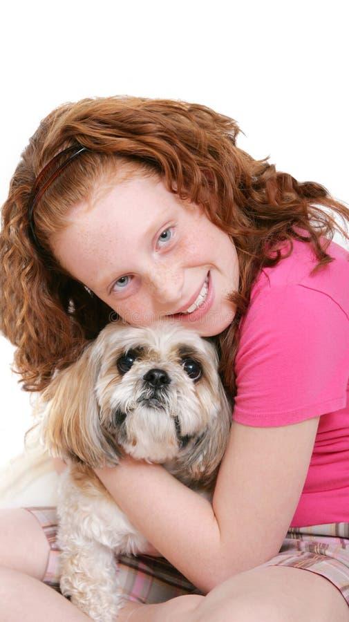 在白色的狗女孩 免版税库存照片
