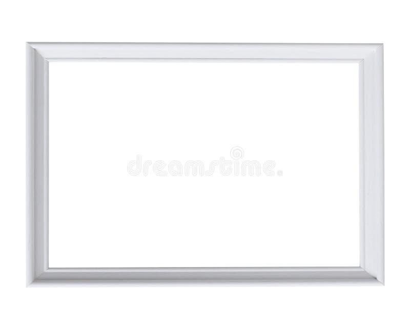 在白色的白色木框架照片 免版税库存照片