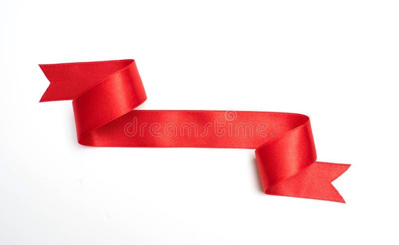 在白色的红色丝带横幅 库存照片