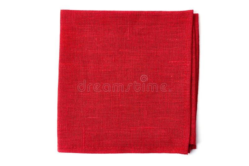 在白色的红色纺织品餐巾 免版税库存照片