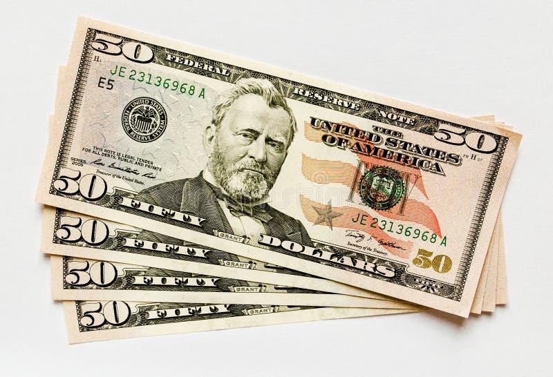 在白色的美国现金 免版税库存照片