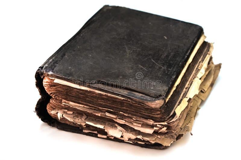 在白色的老破旧的古色古香的书`圣经`隔绝了背景 免版税库存照片