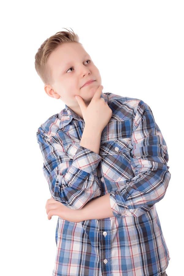 在白色的英俊的男孩cogitate 图库摄影