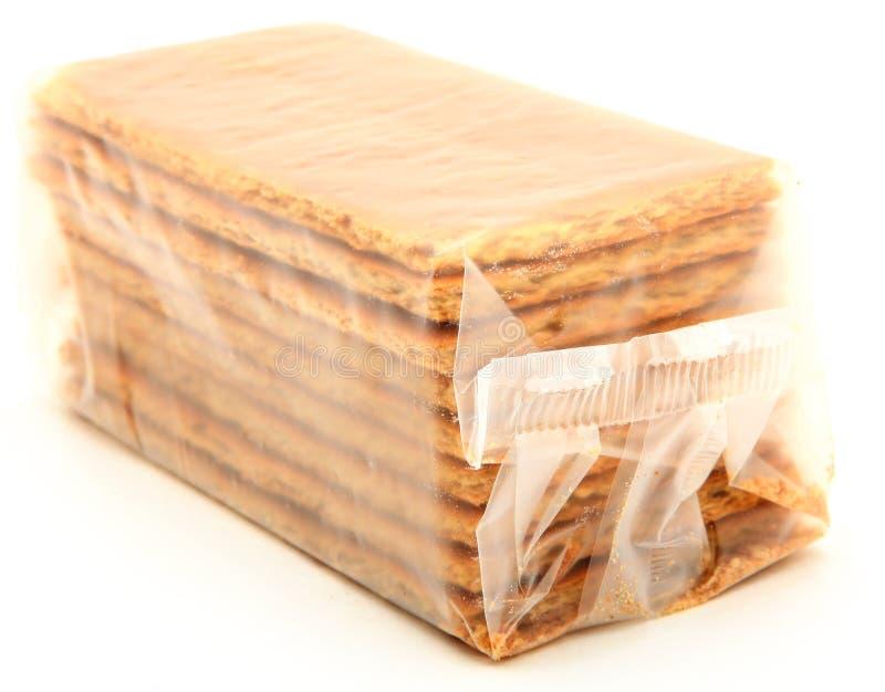 在白色的袋子薄脆饼干格雷姆 免版税库存图片