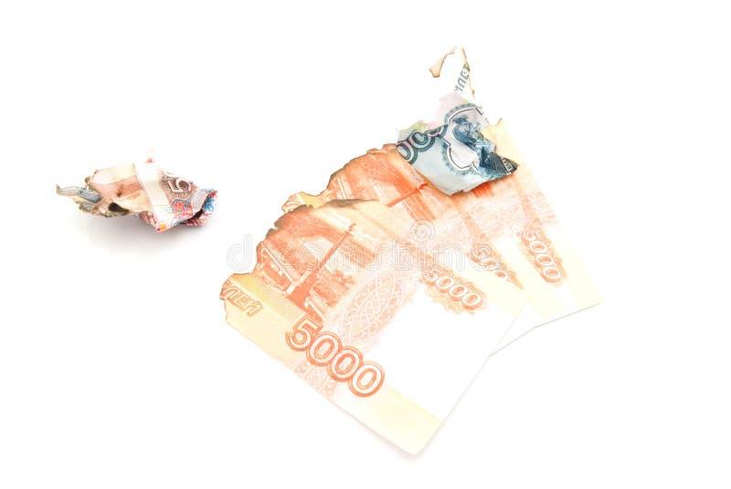在白色的被烧焦的俄国钞票 库存照片