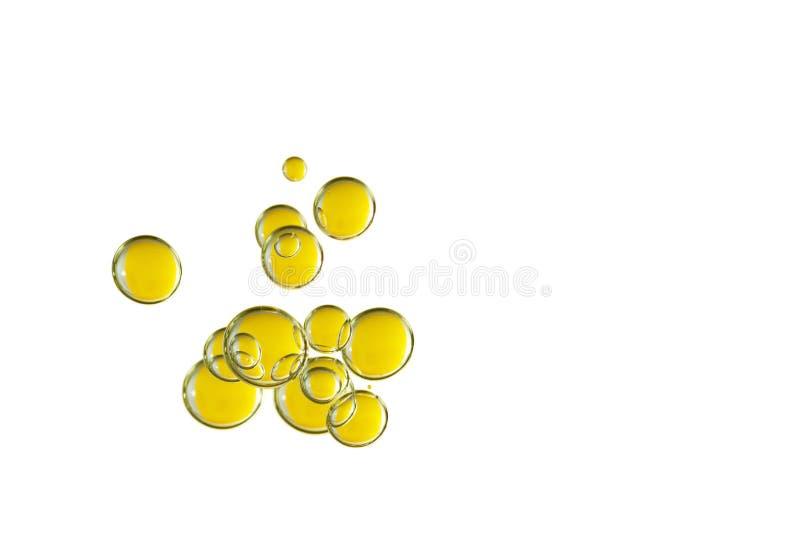 在白色的金黄泡影 库存照片