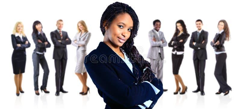 在白色的非裔美国人的女商人 库存照片