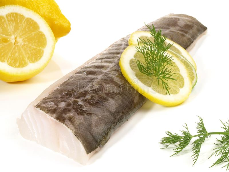 在白色的鳕鱼腰部 免版税库存图片