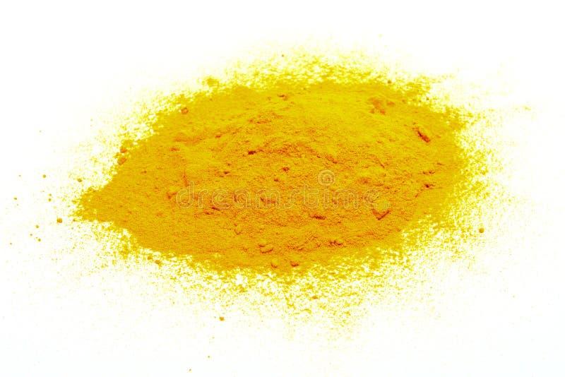 在白色的黄色粉末 库存照片