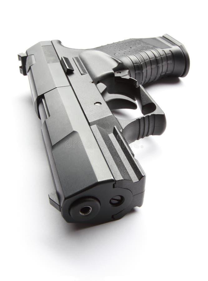 在白色的黑色手枪 库存照片