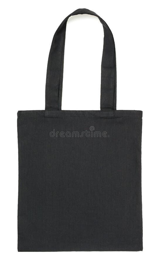 在白色的黑织品袋子 免版税图库摄影
