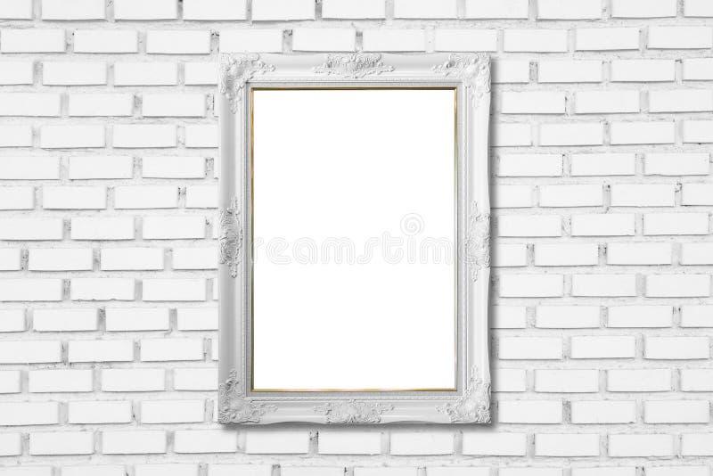 在白色砖墙上的白色框架 免版税图库摄影