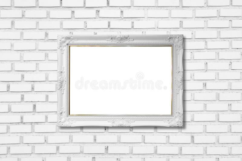 在白色砖墙上的白色框架 免版税库存照片