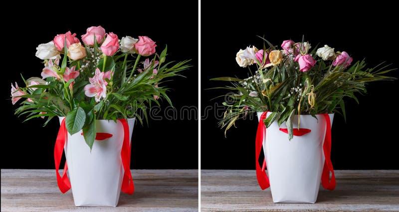 在白色箱子的枯萎的和鲜花花束有在一张木桌上的红色丝带的 在黑色背景 免版税库存图片