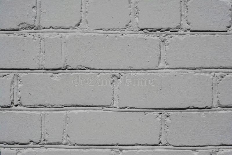 在白色绘的被构造的砖墙,背景 免版税库存照片