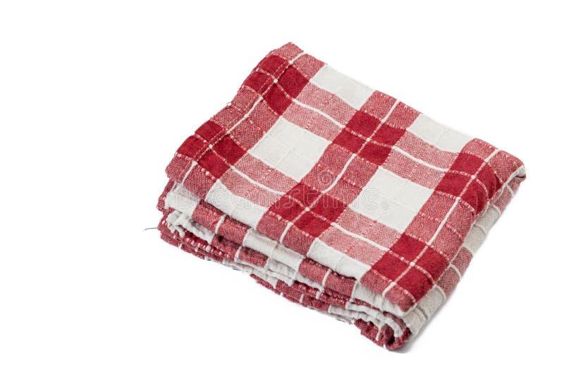 在白色背景上被隔绝的红色白色厨房桌布 免版税库存图片