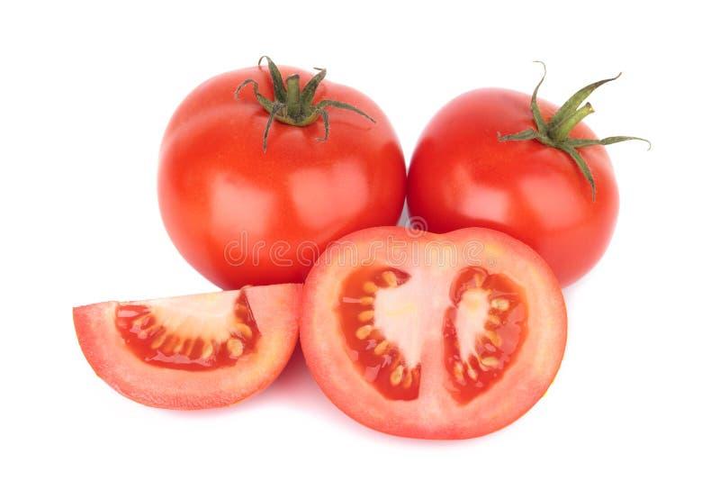 在白色背景与下落的蕃茄隔绝的 免版税图库摄影
