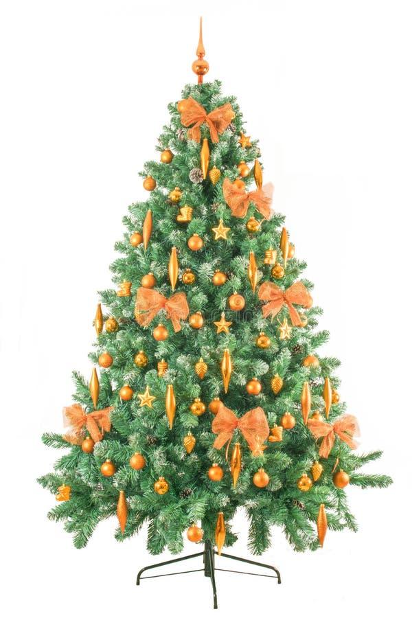 在白色背景与古铜色装饰-全长的现代圣诞树隔绝的 图库摄影