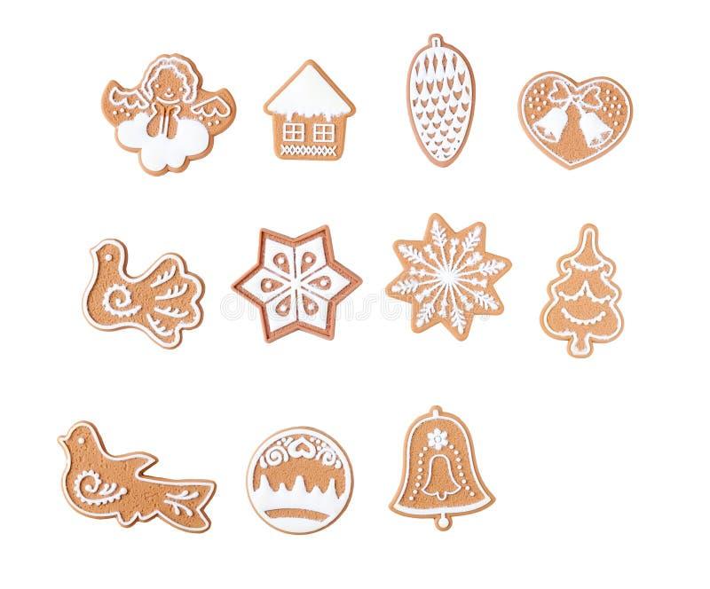 在白色背景与结霜,不同的形状的姜饼隔绝的 库存例证